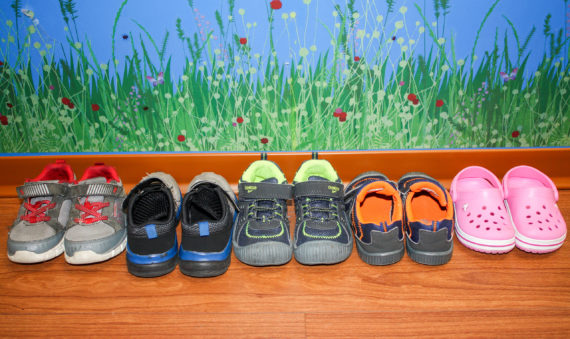 Photo of LAIPT patients' shoes lined up on the floor